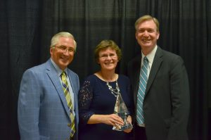 Distinguished Alumni Award recipient Rev. Sandra Sutherland with Chancellor and President