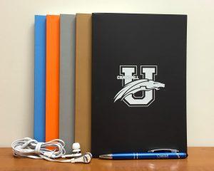 CU Bookstore notebooks, heaphones, pen